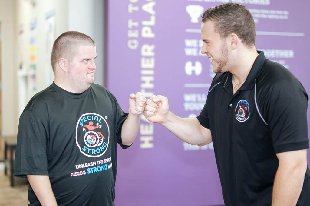 josh-fist-bump-special-needs-autism-exercise