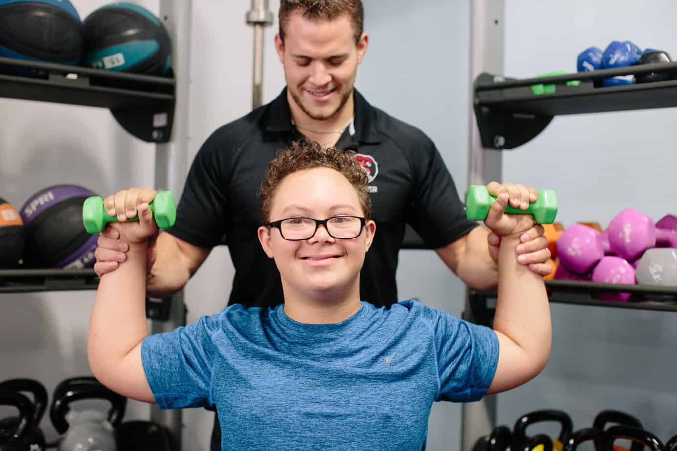 jude-overhead-press-down-syndrome-special-needs-autism-exercise