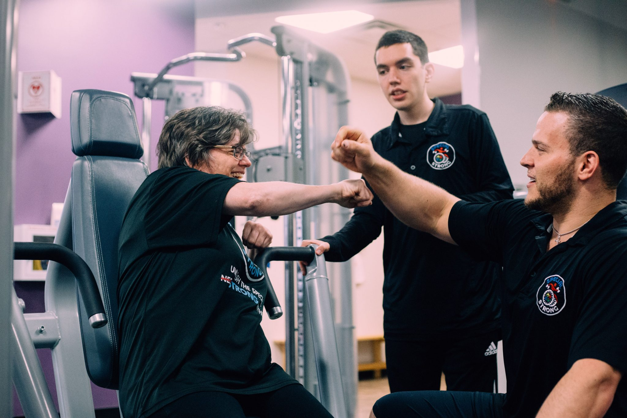 special strong adaptive fitness training fist bump