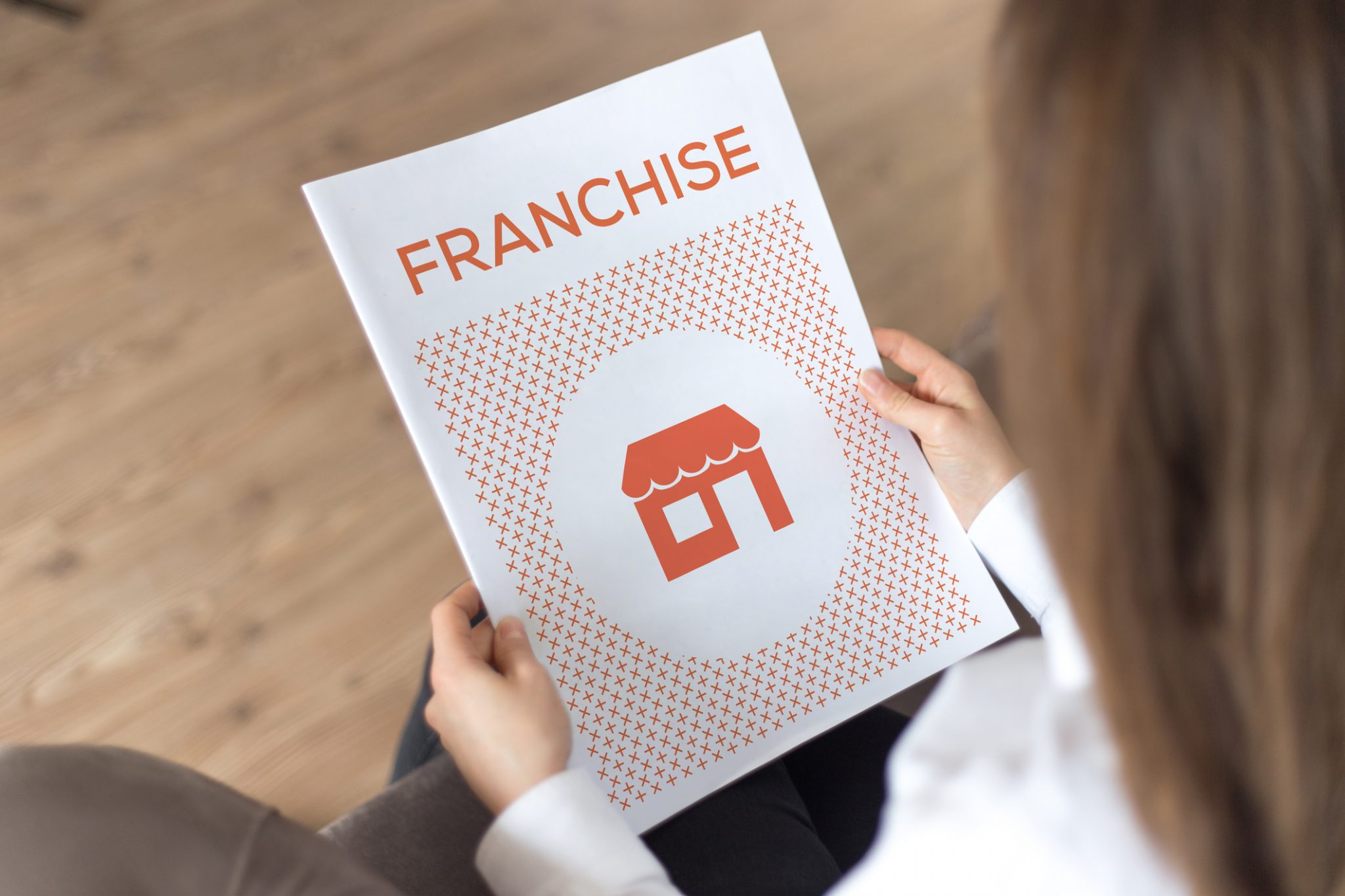 specialstrong- female reading about franchise